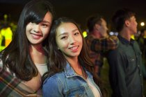 Chinese women standing at music festival — Stock Photo