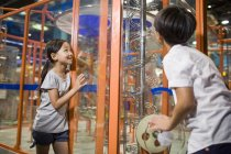 Chinese children looking and interacting at exhibition in museum — Stock Photo