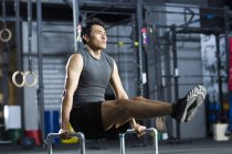Chinese man practicing in crossfit gym — Stock Photo