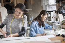 Chinese female tailors working in atelier — Stock Photo
