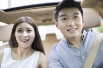 Close-up view of chinese couple sitting in car — Stock Photo