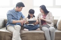 Chinese parents scolding daughter with digital tablet — Stock Photo