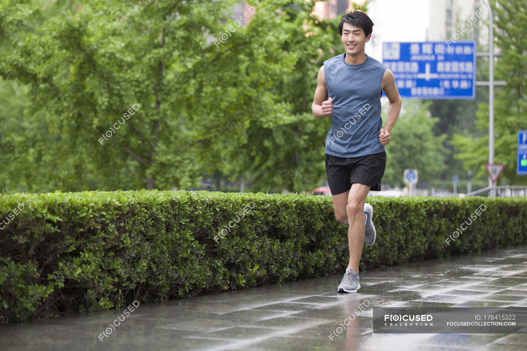 Chinese man running on street — selective focus, healthy