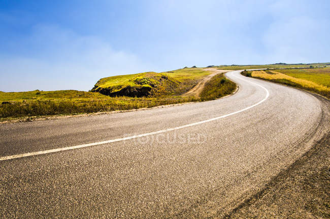 Rural road in grassland scenery in Hebei province, China — Stock Photo