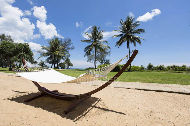 Hammock standing on tropic beach — Stock Photo