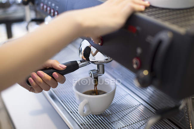 Close-up of barista hands making coffee — Stock Photo