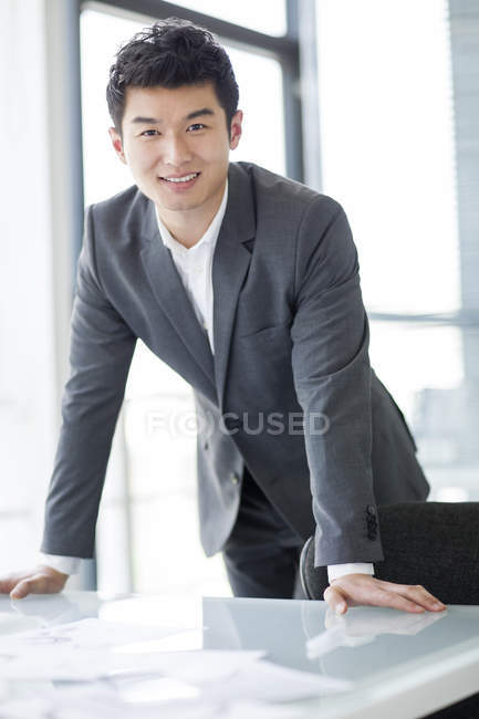 Chinese businessman at workplace in office — Stock Photo