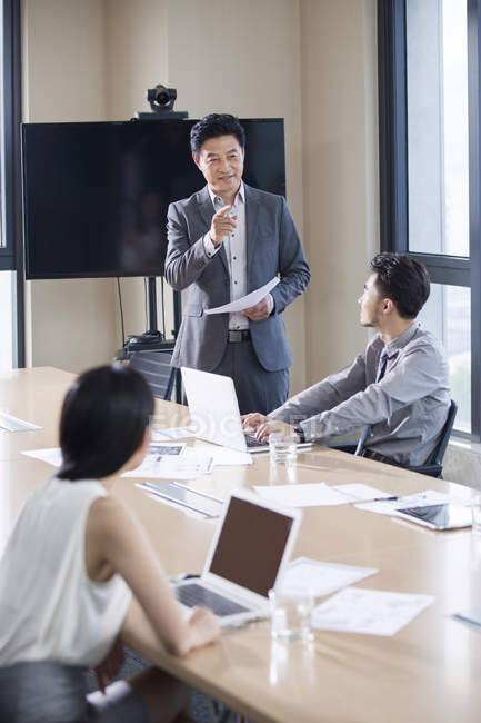 Asian business people talking in meeting room — Stock Photo
