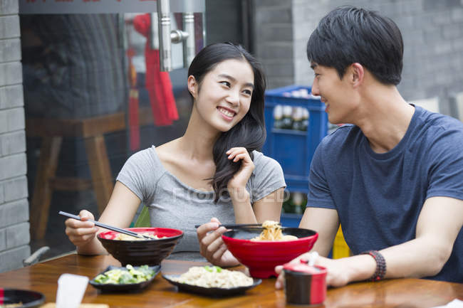 Chinese couple having lunch — Stock Photo
