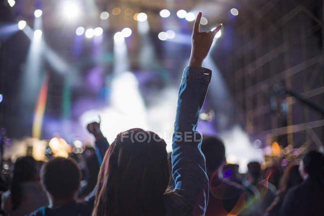 Chinese woman making rock and roll sign at music festival — Stock Photo
