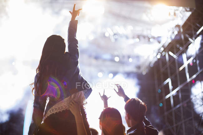 Chinese friends having fun at music festival — Stock Photo