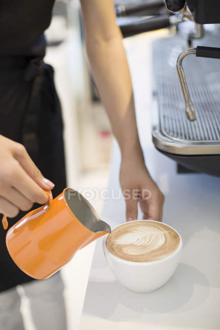 Close-up of barista hands making cappuccino — Stock Photo