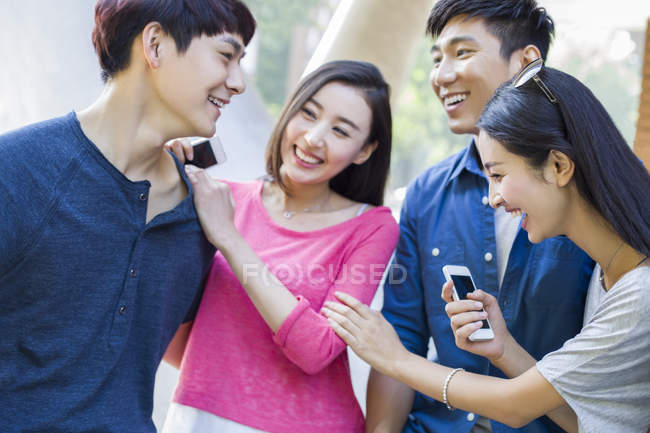 Chinese friends talking together on street — Stock Photo