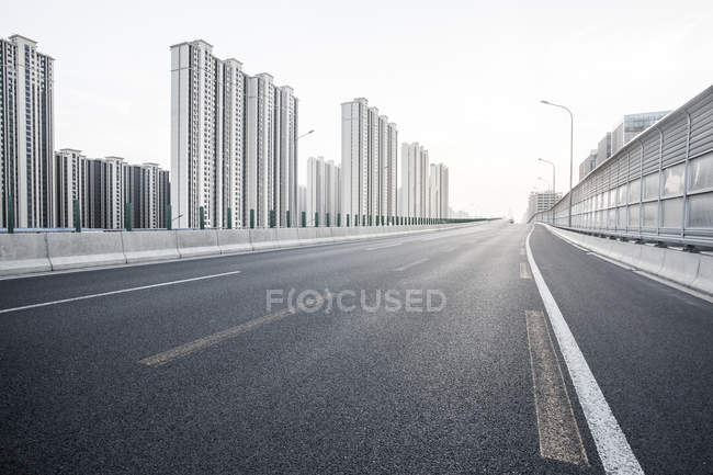 Urban scene of road and modern architecture in China — Stock Photo