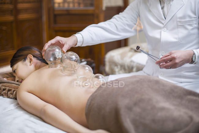 Chinese woman receiving vacuum cupping treatment — Stock Photo