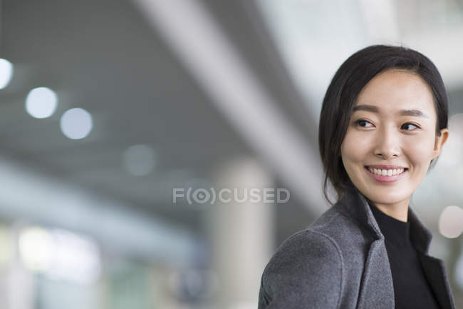 Portrait of asian woman smiling and looking away — Stock Photo