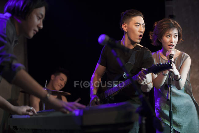 Chinese musical band performing on stage — Stock Photo