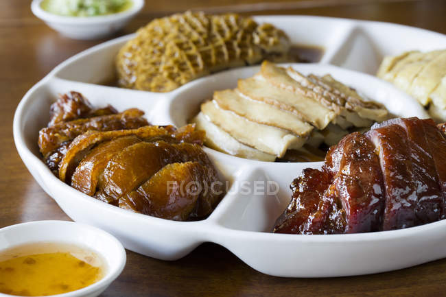 Close-up view of various chinese meals on table — Stock Photo