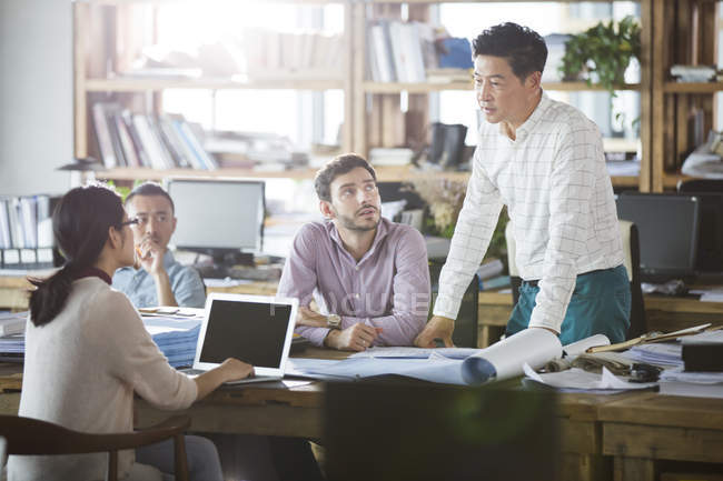 Architects discussing work in office — Stock Photo