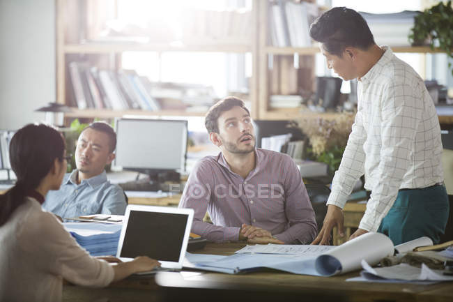 Architects working and talking in office — Stock Photo