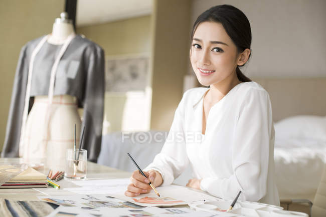 Chinese fashion designer drawing sketch — Stock Photo