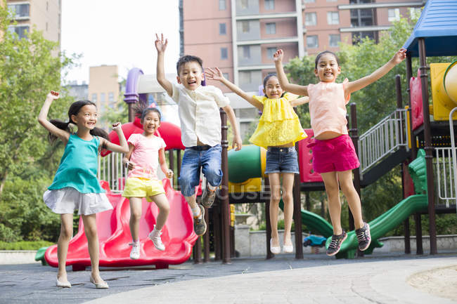 Chinese children playing in amusement park — Stock Photo