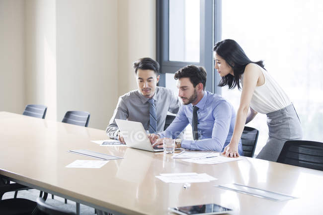 Business people having meeting with laptop in office — Stock Photo
