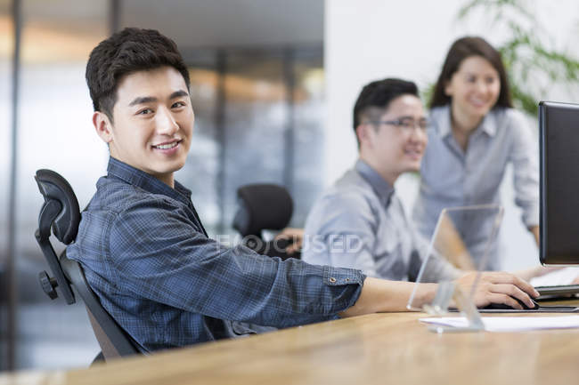 chinese office workers sitting in office selective focus head and