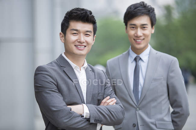 Portrait of chinese businessmen looking in camera — Stock Photo