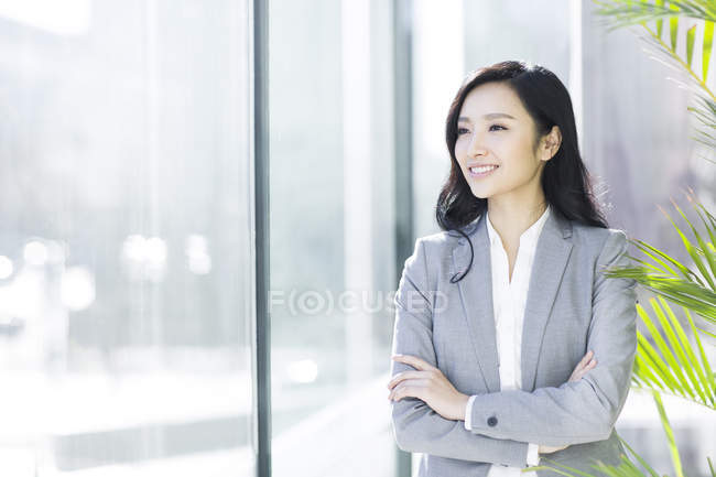 Asian businesswoman with arms crossed — Stock Photo