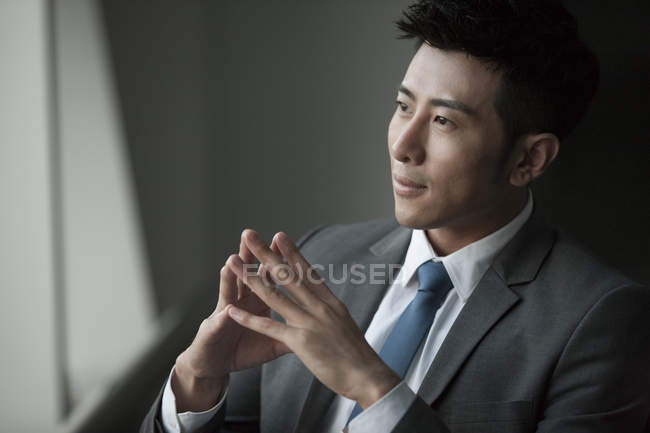 Portrait of pensive chinese businessman — Stock Photo