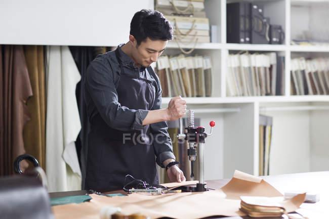 Asian male craftsman working in studio — Stock Photo