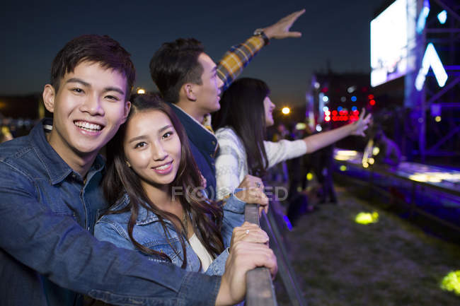Chinese friends watching concert at music festival — Stock Photo