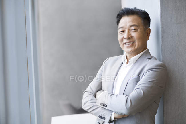Portrait of confident Chinese businessman — Stock Photo