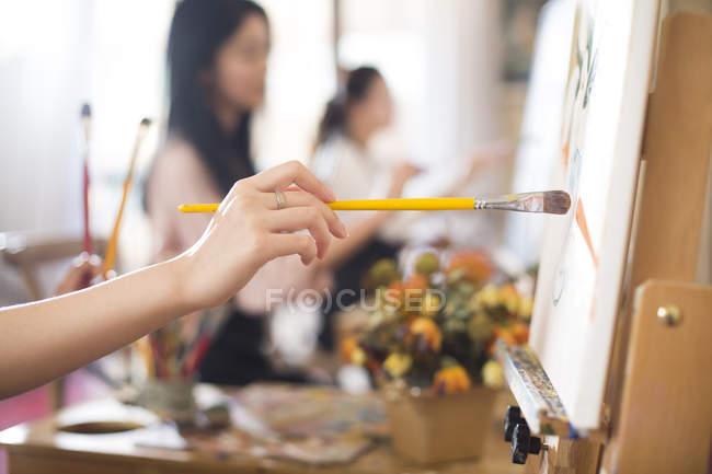 Women painting in art studio — Stock Photo