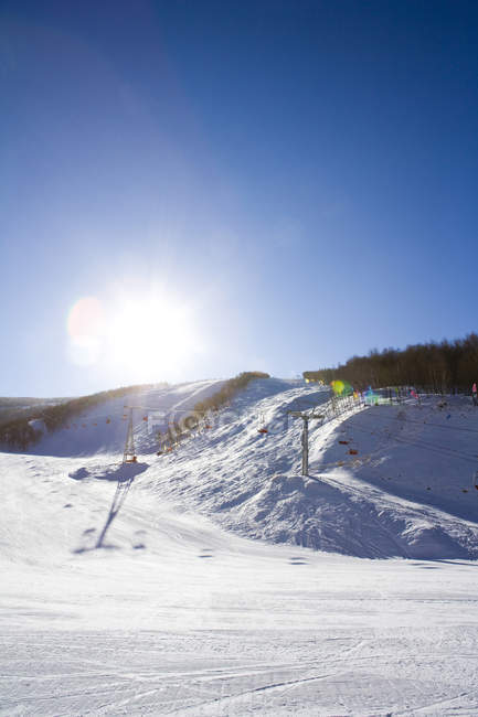 Scenic view of ski lift at winter resort — Stock Photo