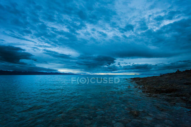 Scenic view of lake under cloudscape in Tibet, China — Stock Photo