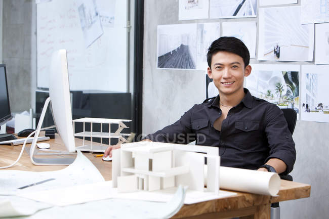 Chinese male architect working in office — Stock Photo