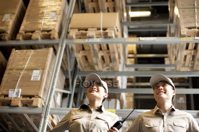 Male and female Chinese warehouse workers — Stock Photo