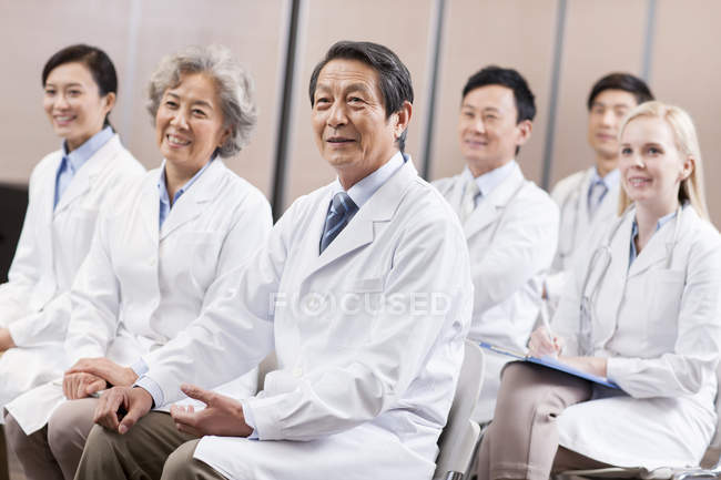 Team of medical workers sitting at meeting — Stock Photo