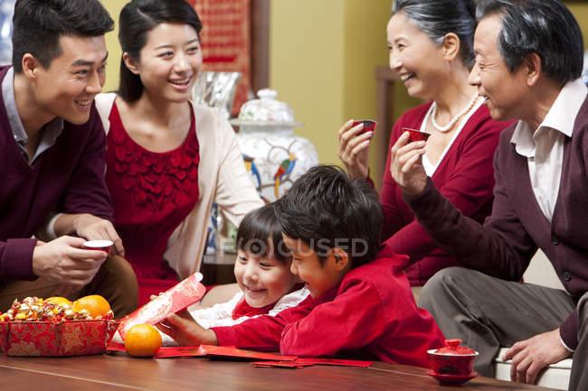 Cheerful multi-generation celebrating Chinese New Year — Stock Photo