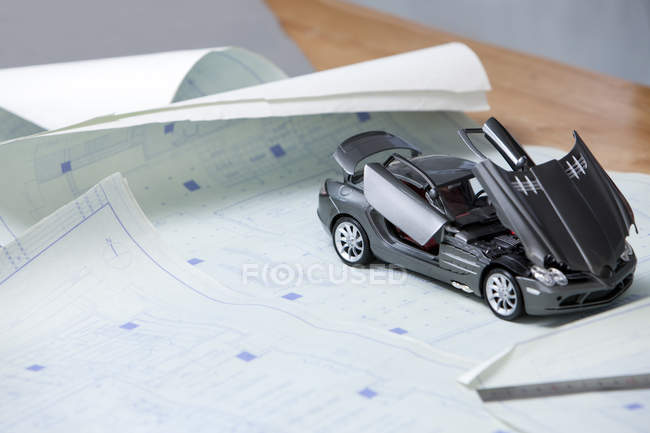 Close-up of model car and blueprints — Stock Photo