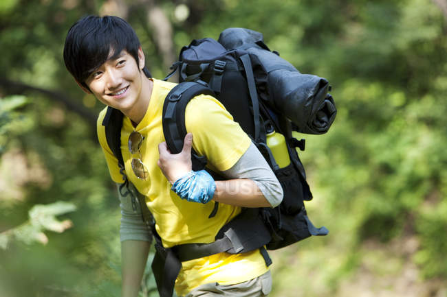 Chinese male hiker in woods — Stock Photo