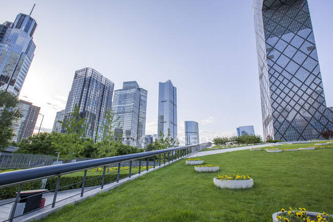 modern buildings and green area in beijing china stock photo