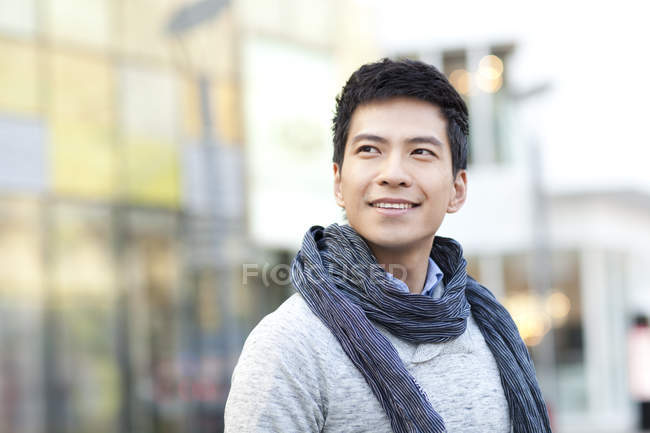 Portrait of fashionable Chinese man looking at view in city — Stock Photo