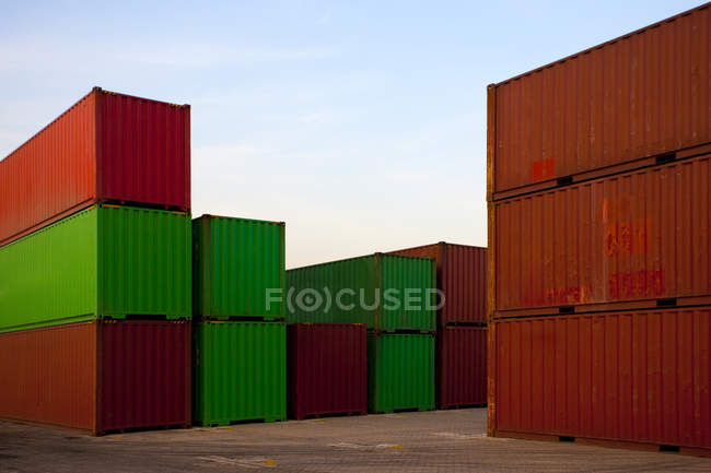 Cargo containers in dock at dusk — Stock Photo