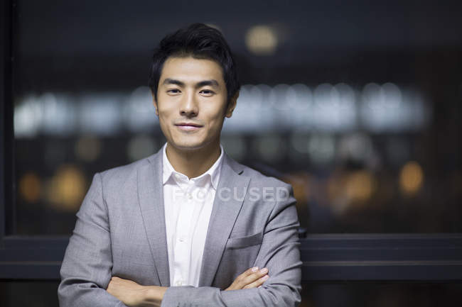 Portrait of Chinese businessman with arms folded — Stock Photo