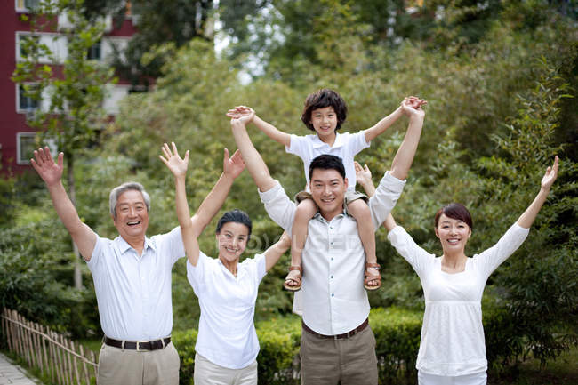 Happy Chinese family posing in residential district — Stock Photo