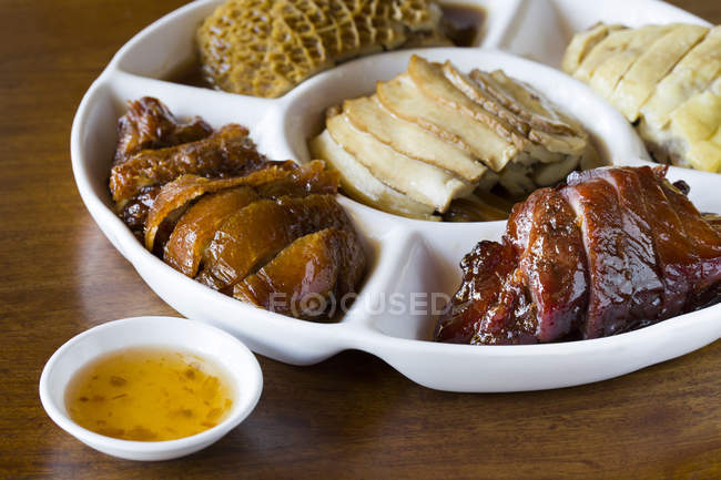 Various chinese meals on portioned plate, close-up — Stock Photo