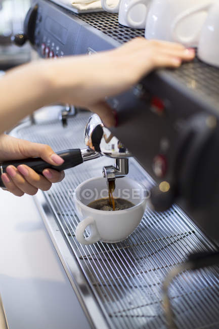 Close-up of barista hands making espresso — Stock Photo